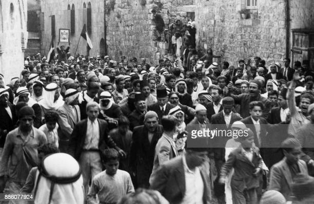 A picture dated before 1937 during the British Mandate in Palestine shows Arabs demonstrating in the Old City of Jerusalem against the Jewish...