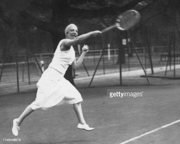 Picture dated from the '20s of French tennis player Suzanne Lenglen volleying a ball. Suzanne Lenglen, who died in 1938 at the age of 39, remains the...