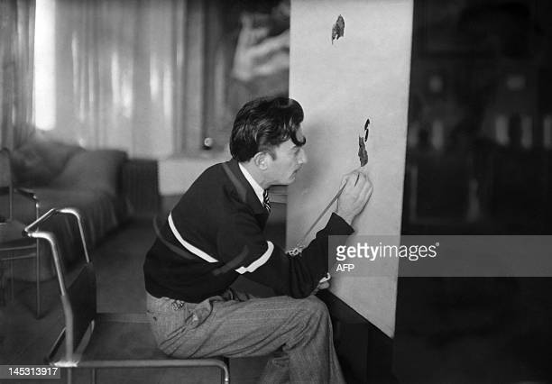 Picture dated in the 30s of Spanish artist Salvador Dali painting / AFP /