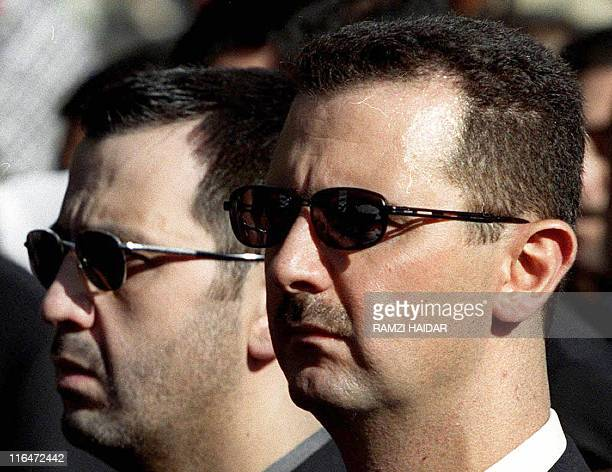A picture dated June 13 2003 shows Syrian President Bashar alAssad and his brother Maher attending their father's funeral in Damascus on June 13 2000...