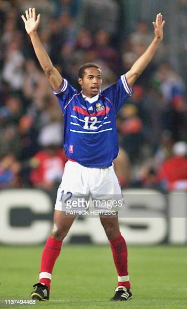 Picture dated late 12 June showing French forward Thierry Henry who scored the third goal for his team celebrating at the Velodrome Stadium in...