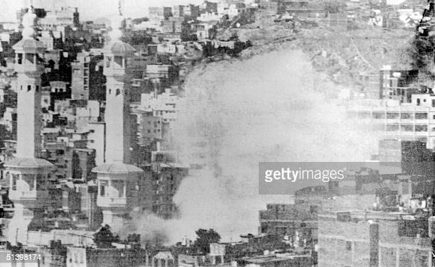 Picture dated November 1979 of burning Mecca's Great Mosque the home of Islam's holiest sites attacked 20 November 1979 by Moslem gunmen belonging to...