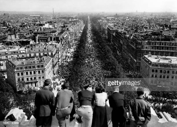 Picture dated of May 8 1945 showing people looking at the crowded Champs Elysees Avenue from the Triumphal Arch as Parisians gathered in the streets...