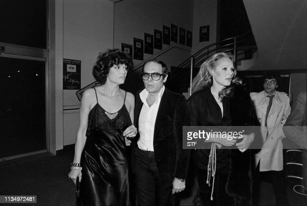Picture dated of November 24, 1975 of Italian actress Claudia Cardinale, director Pasquale Squitieri and Ursula Andress attending the preview of the...