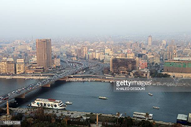 A picture dated on February 2 2012 shows boats on the river Nile as traffic moves along the 6 October bridge in Cairo AFP PHOTO/ KHALED DESOUKI