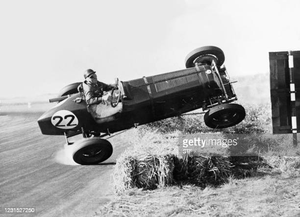 Picture dated on October 2, 1948 of a pilot, Geoffrey Ansell, turning a somersault during the International Grand Prix at Silverstone. Although the...