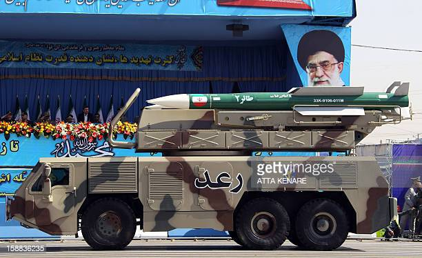 A picture dated September 21 shows a Raad air defense system carrying Taer missiles being displayed by Iran's Revolutionary Guard during an annual...