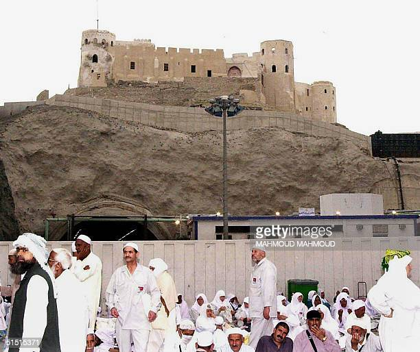Picture dates March 2001 shows Muslim pilgrims sitting under an Ottoman fortress overlooking the Grand Mosque in Islam's holiest city of Mecca Saudi...