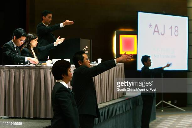 Picture during the auction of ordinary and special vehicle registration marks at the Hong Kong Convention and Exhibition Centre in Wan Chai 05...