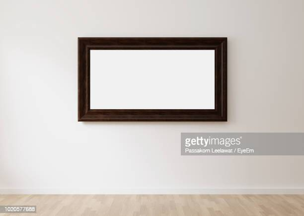 Picture Frame Mounted On Wall At Home