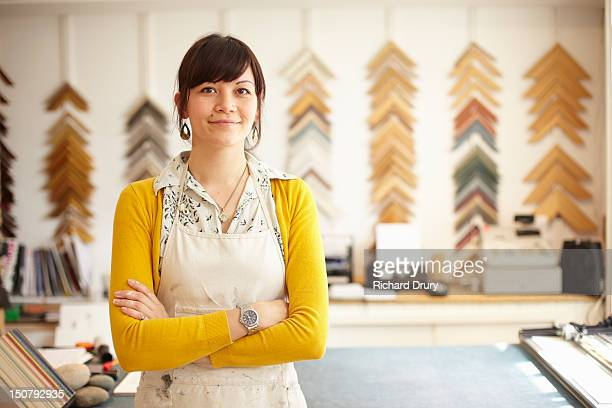 picture framer in her shop - entrepreneur stock pictures, royalty-free photos & images
