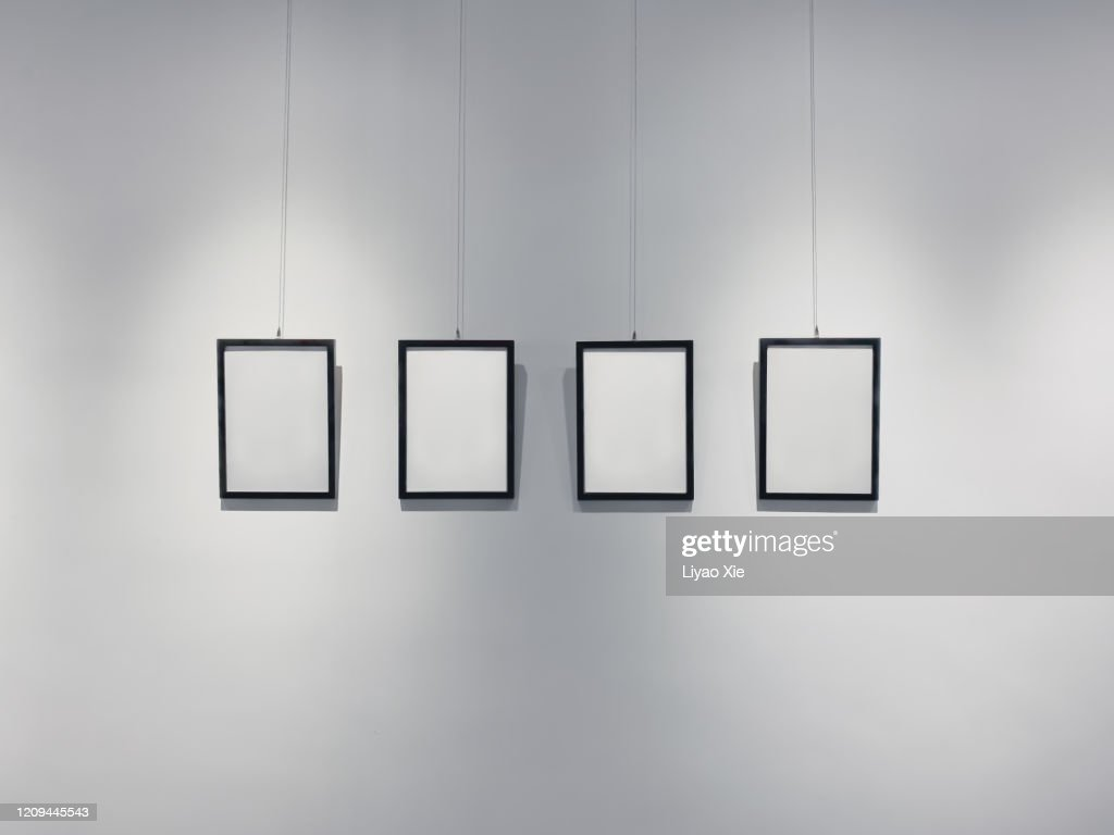 Picture frames on the wall : Stock Photo