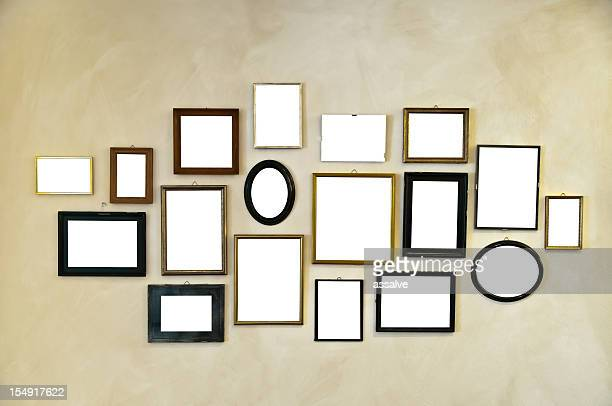 picture frames on vintage wall painting - muur stockfoto's en -beelden