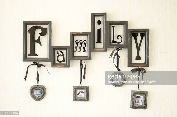 Picture Frames With Family Text Mounted On Wall