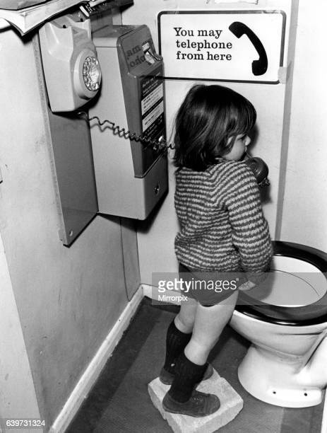 A picture from a series of humurous novelty images taken by Sunday People photographer Dennis Hutchinson A child answers the call of nature payphone...