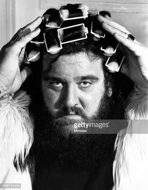 A picture from a series of humurous novelty images taken by Sunday People photographer Dennis Hutchinson The wrestler Giant Haystacks with rollers in...