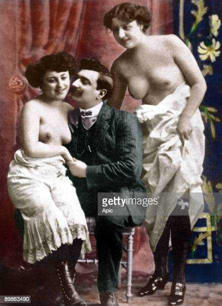 Picture from erotic cards showing young women in a brothel with a client early 20th century