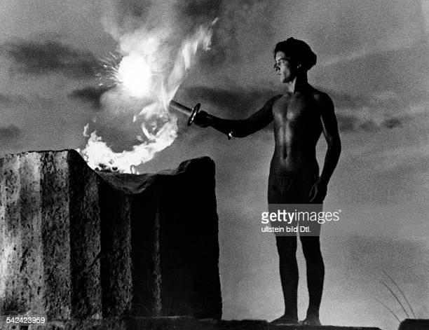 Picture from Leni Riefenstahl's book 'Beauty in the Olympic fight': - Iightning the Olympic flame at the historic site in Greece- August 1936 Vintage...