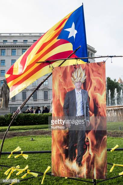 A picture in front of a banner depecting Catalonia's ousted leader Carles Puigdemont characterized as Goku of the Japanese animated serie 'Dragon...