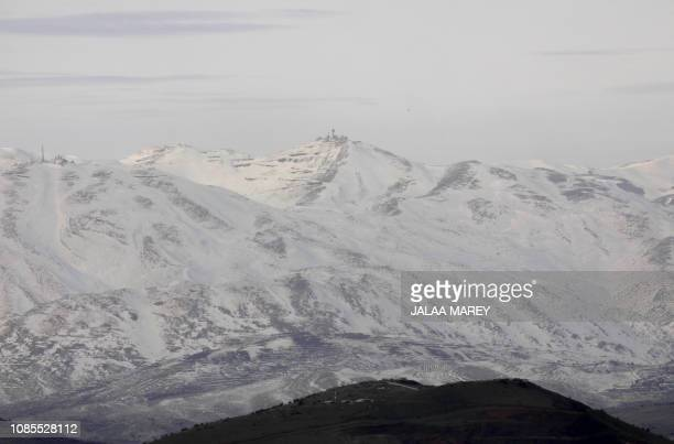 A picture in the Israeliannexed Golan Heights shows snow covered mountain inside Syria on January 20 2019 Israel's military said its air defence...