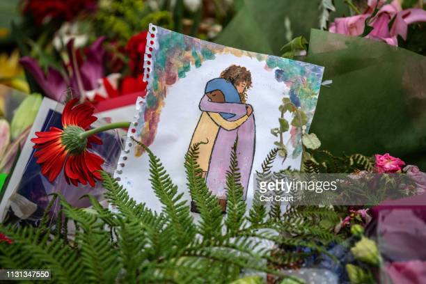 A picture is left among flowers and tributes near Al Noor mosque on March 18 2019 in Christchurch New Zealand 50 people were killed and dozens are...