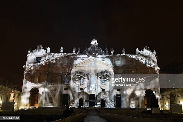 A picture is projected on the cupola of St Peters Basilica during the show Fiat Lux Illuminating Our Common Home on December 8 2015 at the Vatican...