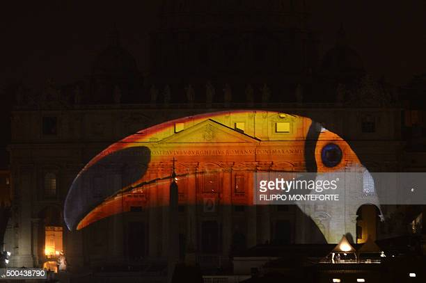 A picture is projected on the facade and the cupola of St Peters Basilica during the show Fiat Lux Illuminating Our Common Home on December 8 2015 at...