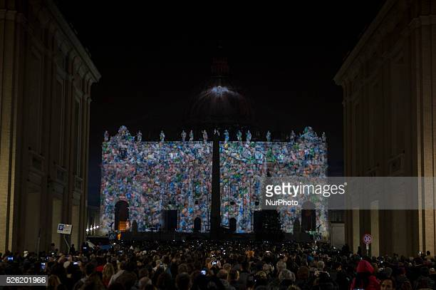 Picture is projected on the facade and the cupola of St. Peters Basilica during the show Fiat Lux : Illuminating Our Common Home, on December 8, 2015...