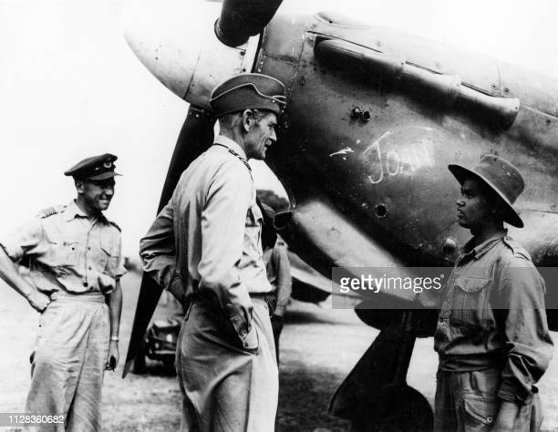 Picture issued April 1945 on Ramee Island showing British Air Marshal Sir Keith Park talking to members of the ground crew during the British...