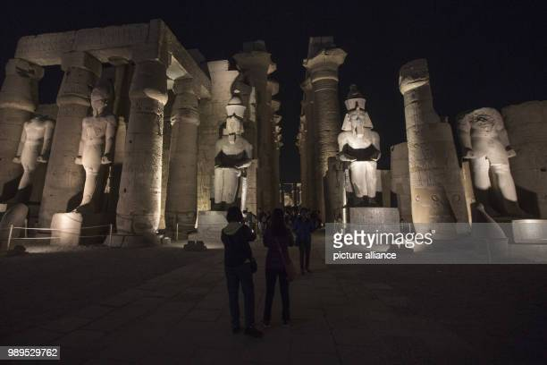 A picture issued on 24 December 2017 shows tourists attending a light show at the Luxor Temple in Luxor Upper Egypt 10 December 2017 Photo Gehad...