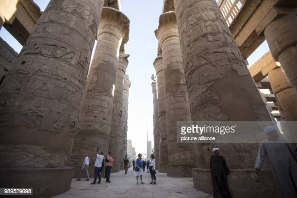 A picture issued on 24 December 2017 shows tourists walking at the hall of columns at the Karnak Temple in Luxor Upper Egypt 08 December 2017 Photo...