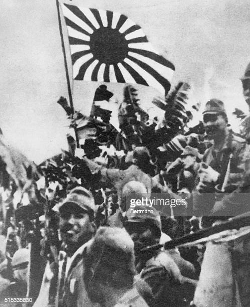 Picture just received shows triumphant Japanese Troops hoisting their flag over Singapore after the British surrender