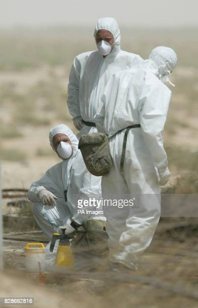 Picture made available of Army chemical weapons experts examining one of `Chemical Ali's' former bases near Basra where initial examinations show...