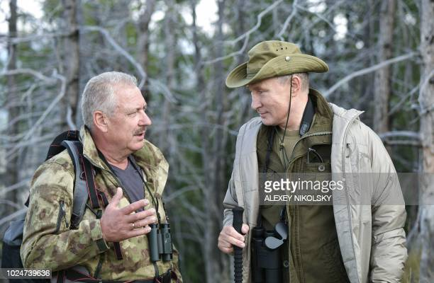 A Picture made available on August 27 shows Russia's President Vladimir Putin during his vacation in the SayanoShushensky nature reserve in the...