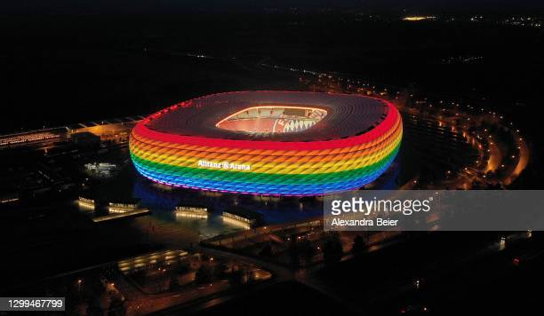 Picture, made with a drone, shows the Allianz Arena soccer stadium illuminated in rainbow colours during the Bundesliga match between FC Bayern...