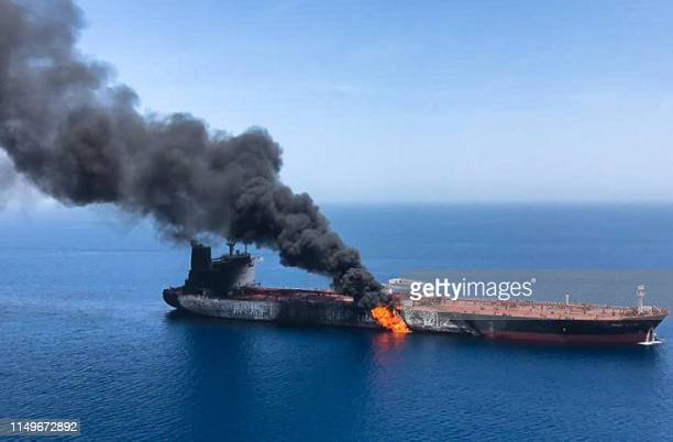 Picture obtained by AFP from Iranian News Agency ISNA on June 13, 2019 reportedly shows fire and smoke billowing from Norwegian owned Front Altair...