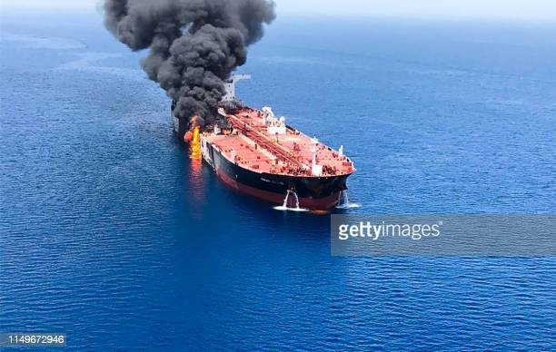 A picture obtained by AFP from Iranian News Agency ISNA on June 13 2019 reportedly shows fire and smoke billowing from Norwegian owned Front Altair...