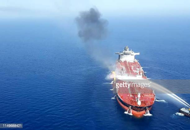 A picture obtained by AFP from Iranian news agency Tasnim on June 13 2019 reportedly shows an Iranian navy boat trying to control fire from Norwegian...