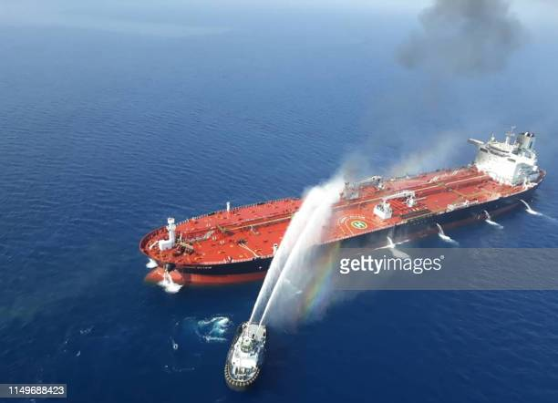 TOPSHOT A picture obtained by AFP from Iranian news agency Tasnim on June 13 2019 reportedly shows an Iranian navy boat trying to control fire from...