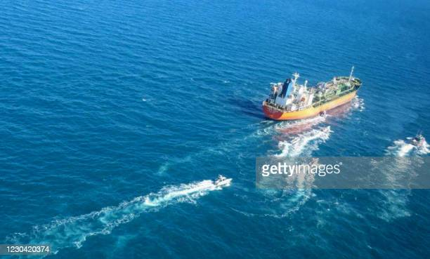 Picture obtained by AFP from the Iranian news agency Tasnim on January 4 shows the South Korean-flagged tanker being escorted by Iran's Revolutionary...