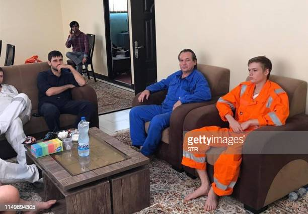 A picture obtained by AFP from the Iranian news agency Tasnim on June 14 2019 shows what they say are some of the crew of the oil tankers which were...