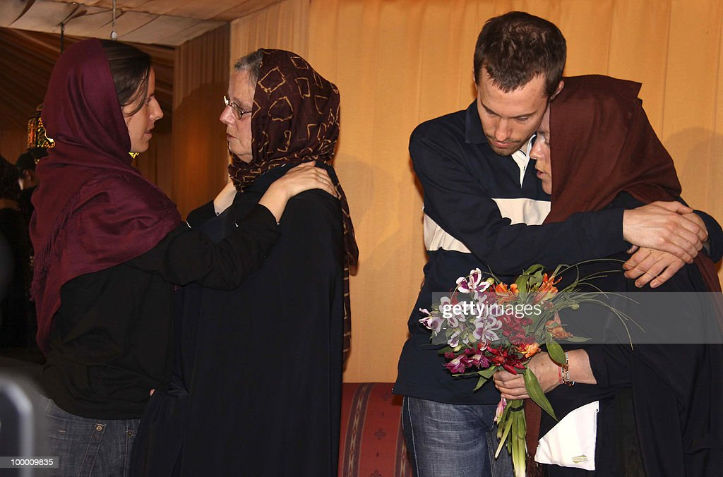 A picture obtained from Iran's state-run English-language Press TV shows detained US hikers Shane Bauer (2nd-R) and Sarah Shourd (L) hugging their mothers Cindy Hickey (R) and Nora Shourd (2nd-L) during their first meeting since their arrest, in the Iranian capital Tehran on May 20, 2010. The mothers of three US hikers detained for 10 months in Iran called for their release as a 'humanitarian gesture' after an emotional reunion with their children, an AFP correspondent said.