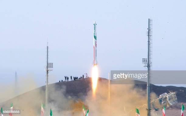 A picture obtained on December 14 2013 from Iran's ISNA news agency allegedly shows the launch of the Pajohesh rocket containing a live space monkey...