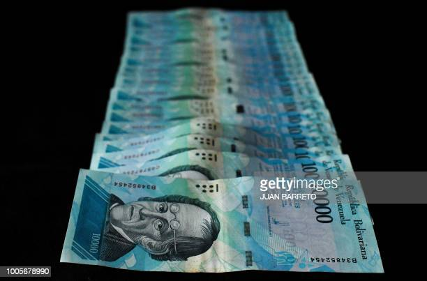 Picture of 10000 bolivarbill taken in Caracas on July 26 2018 Venezuelan President Nicolas Maduro on July 25 announced the removal of five zeroes...