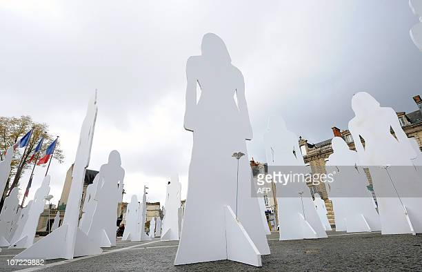Picture of 166 silhouettes representing French women victims of violence in 2007 taken on November 25 2010 in Le Mans as part of the International...
