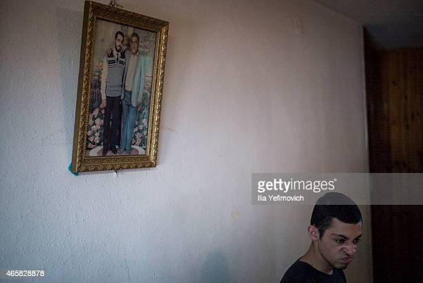 Picture of 19yearold Muhammad Musallam an Israeli Arab executed by Islamic State in Syria sits in his home on March 11 2015 in East Jerusalem Israel...
