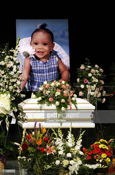 A picture of 23monthold Lyndsey Michelle Harper is displayed over her casket at the funeral for her and four family members who were found shot to...