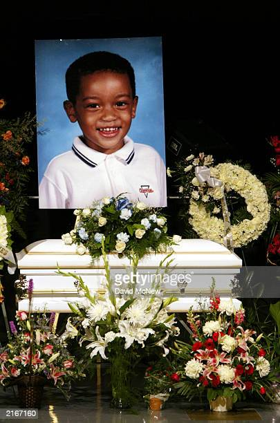 A picture of 4yearold Marques Juwan Harperis displayed over his casket at the funeral for him and four family members who were found shot to death in...
