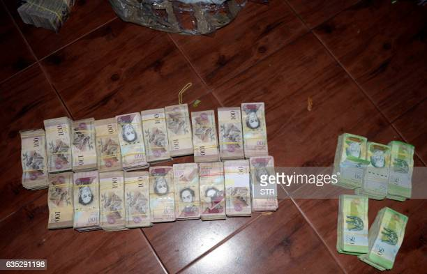 Picture of 50 and 100Venezuelan Bolivar bills part of a hoard weighing about 30 tons seized by Paraguay's National Police at a house in Salto del...