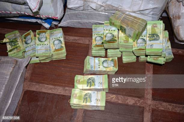 Picture of 50Venezuelan Bolivar bills part of a hoard weighing about 30 tons seized by Paraguay's National Police at a house in Salto del Guaira...